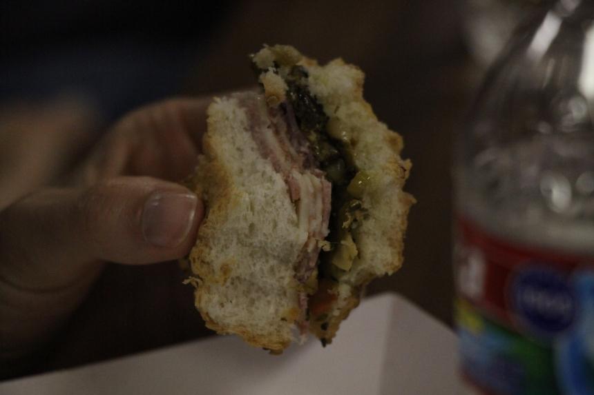 Last bites of a muffuletta