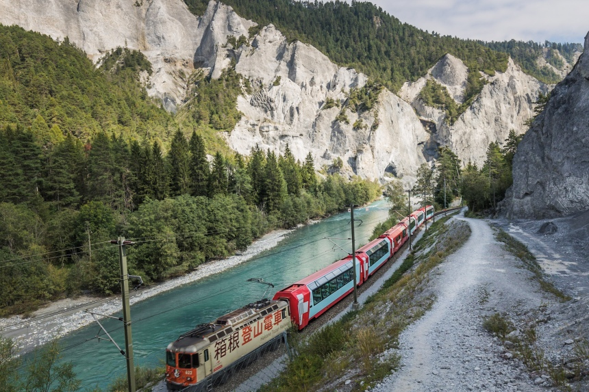 Glacier Express passing through Rhine Gorge close to Versam-Safien station.